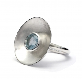 Brushed silver disc ring with blue topaz