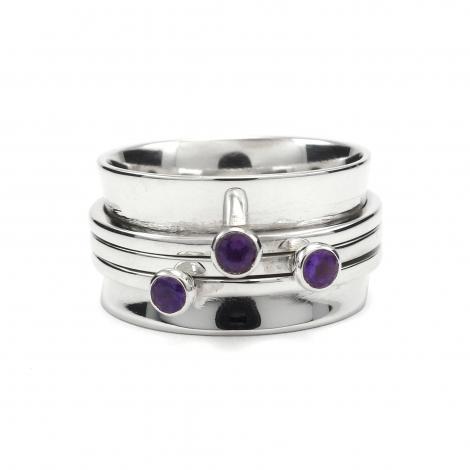 Silver cuff ring with cut amethyst
