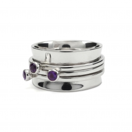 Silver cuff ring with cut amethyst