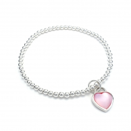 Silver balls bracelet with pink shell heart
